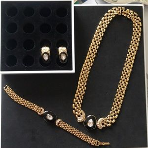 Gold plated necklace, bracelet and earrings.